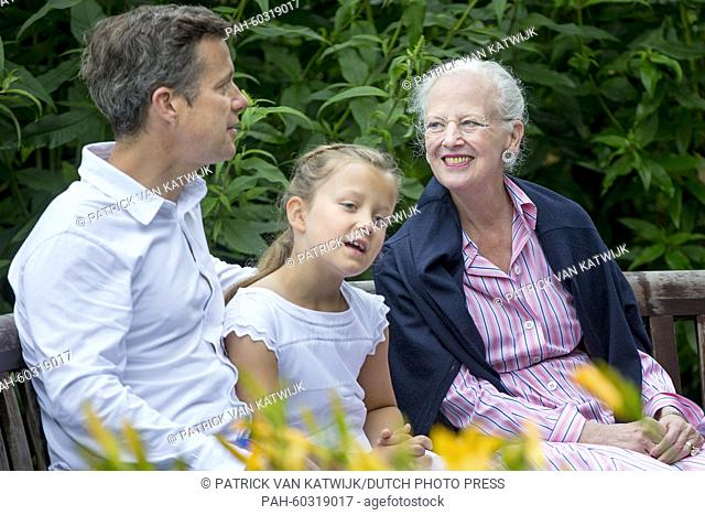 Danish Queen Margarethe, Crown Prince Frederik and Princess Isabella during a photo session during their summer holidays at Grasten Slot, Denmark, 25 July 2015