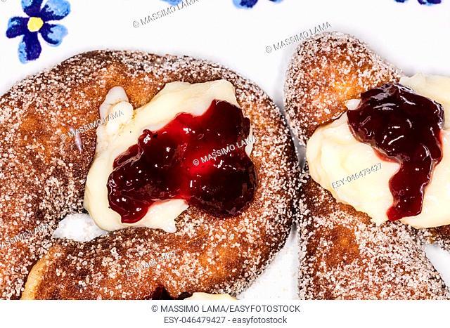 Graffa, neapoitan fried donut made with potato, cream and jam
