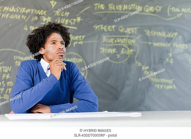 Student listening at desk in class