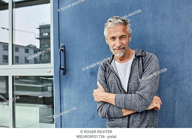 Portrait of mature man in front of gym