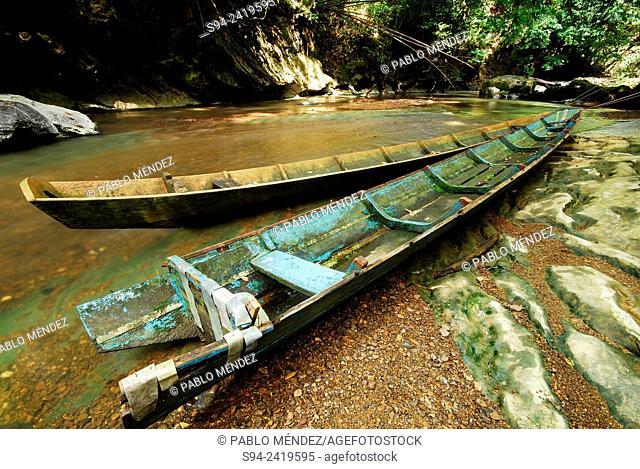 Boats in the river near Kampung Giam, region of Padawan, Sarawak, Malaysia, Borneo