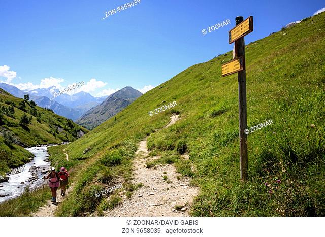 Women trekking in the Valley Ferrand, Oisans, France