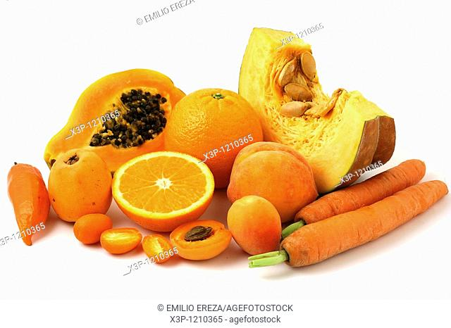 Orange color fruit and vegetables still life