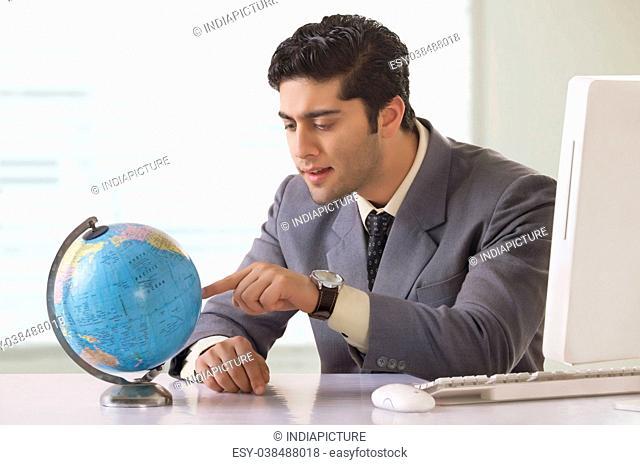 Businessman looking at globe