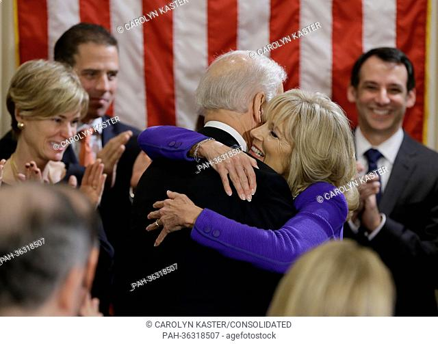 United States Vice President Joe Biden hugs his wife Jill Biden after taking the oath of office during and official ceremony at the Naval Observatory, Sunday