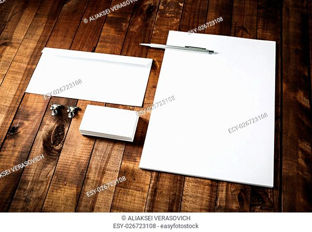 Blank business brand template on wooden table background. Blank stationery set. Corporate identity template. Letterhead, business cards, envelope and pen