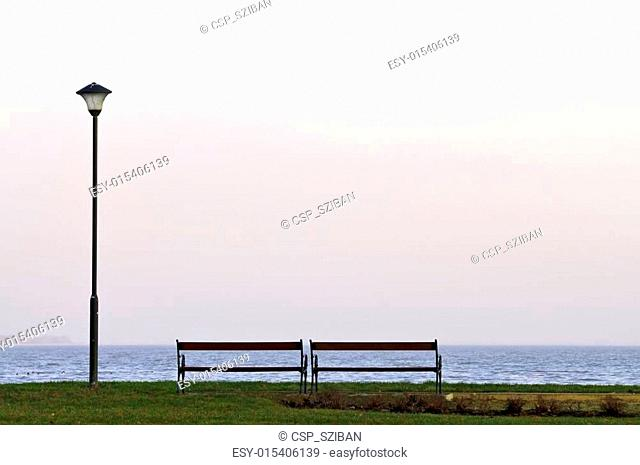 Bench and lamp post at lakeside horizontal