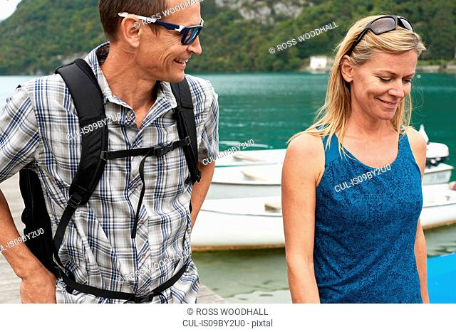 Mature couple strolling by Lake Annecy, Annecy, Rhone-Alpes, France