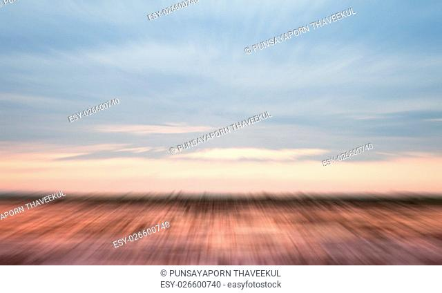 Sunrise on the lake with beautiful sky with motion blur background