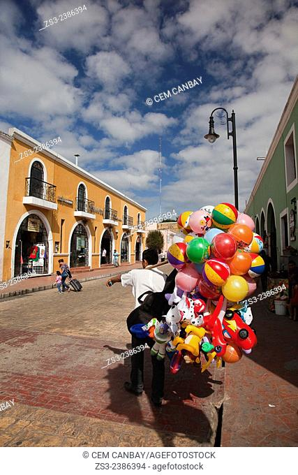 Street scene from the historic center with a vendor in the foreground, Valladolid, Yucatan Province, Mexico, Central America
