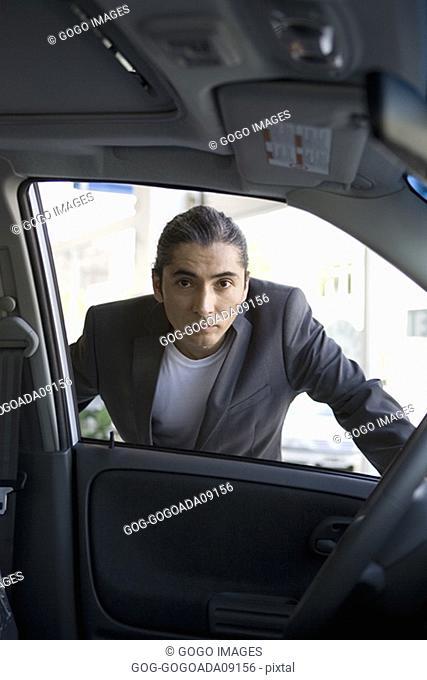 Man examining new car