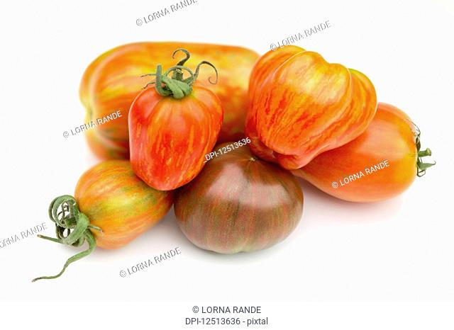 Collection of heirloom tomatoes on a white background