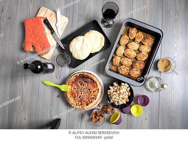 Freshly baked food and cooking equipment, still life, overhead view