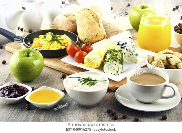 Breakfast served with coffee, orange juice, cheese, cereals and scrambled eggs. Balanced diet