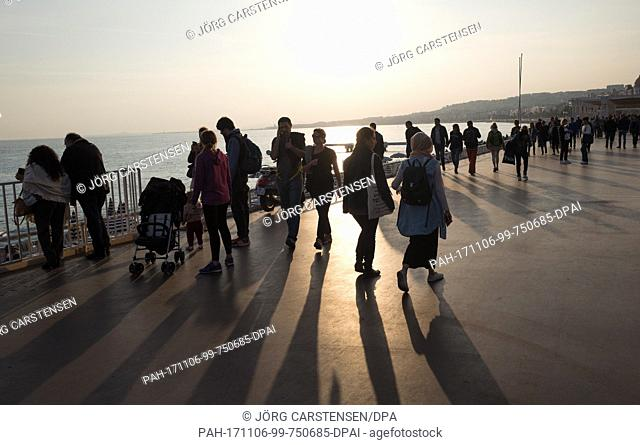 The sun sets over the beach promenade next to the Promenade des Anglais in Nice, France, 1 November 2017. The terrorist attack pn the 14th of July 2016 killed...