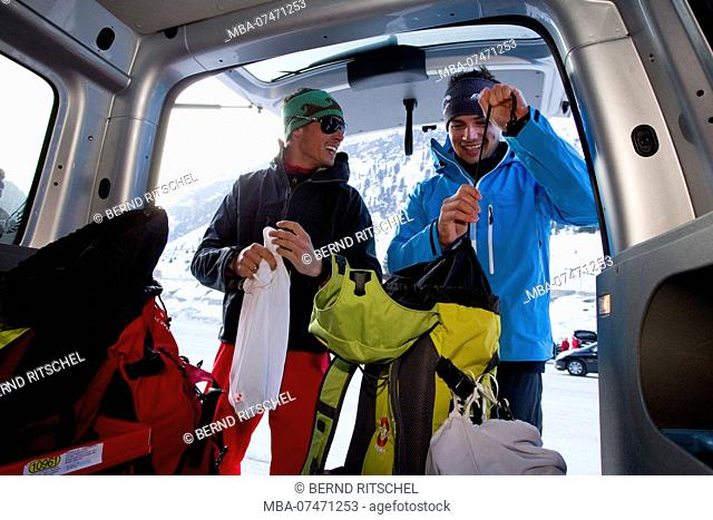 Men packing before freeride tour at the Egesengrat, Stubaier Alps, Tyrol, Austria