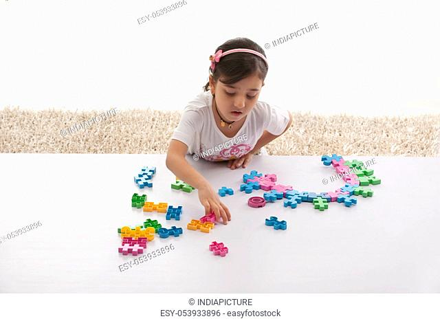 Girl looking for toy pieces