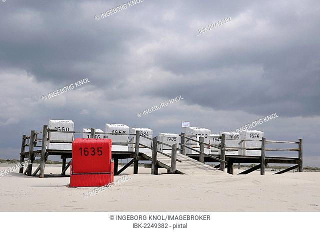 Roofed wicker beach chairs on a platform on stilts, beach on the North Sea, St. Peter-Ording, Schleswig-Holstein, Germany, Europe
