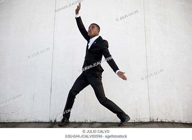 Young Adult Man in Dance Pose