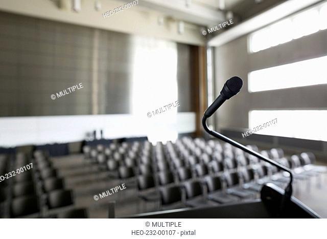 Microphone on podium in empty auditorium