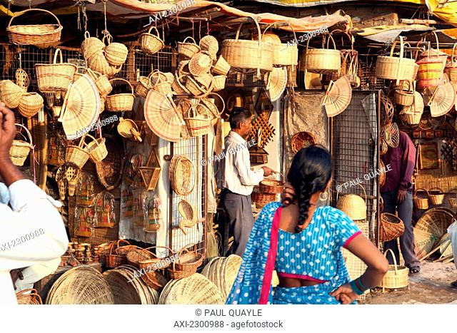 Local handicraft baskets and other goods for sale at this stall near the bathing ghats. The culture of Varanasi is closely associated with the River Ganges and...