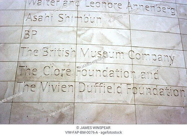 BRITISH MUSEUM GREAT COURT, GREAT RUSSELL STREET, LONDON, WC1 BLOOMSBURY, UK, FOSTER & PARTNERS, INTERIOR, DETAIL OF TEXT ON STONE WALL OF EXTERIOR ON READING...