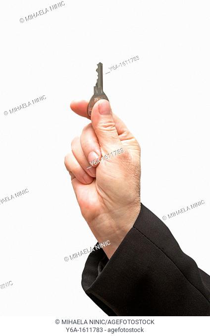 Mature businesswoman`s hand holding key