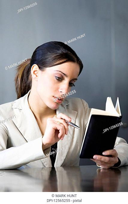 Business woman looking at her planner