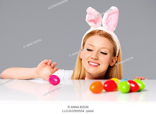 Cute bunny woman with Easter eggs Debica, Poland