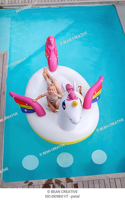 Mother and son in inflatable in pool