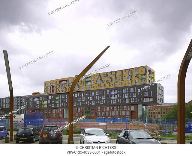 Oblique elevation across parking lot. Chips, Manchester, United Kingdom. Architect: Alsop, 2012