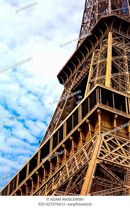 eiffel tower renovation - worker painting a pillar