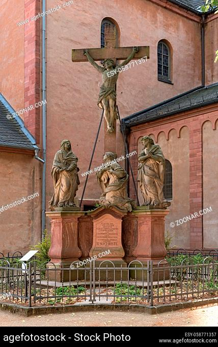 three sandstone sculptures in front of the church of st. marcellinus and peter, seligenstadt, hesse, germany