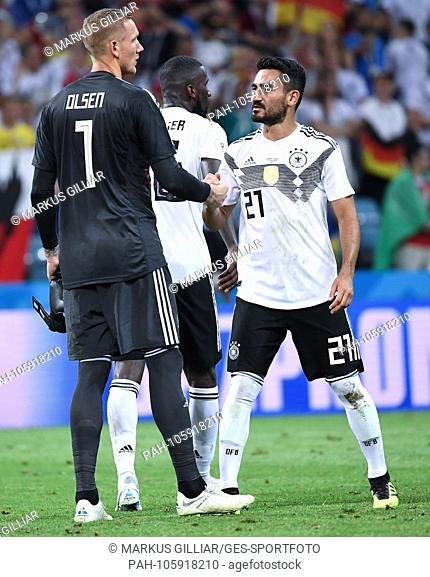 after the match congratulates goalkeeper Robin Olsen (Sweden) / l. Ilkay Guendogan (Germany) / r. GES / Football / World Cup 2018 Russia: Germany - Sweden, 23