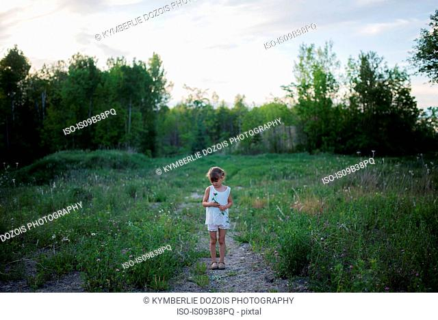 Little girl on grass field, Vancouver, British Columbia, Canada