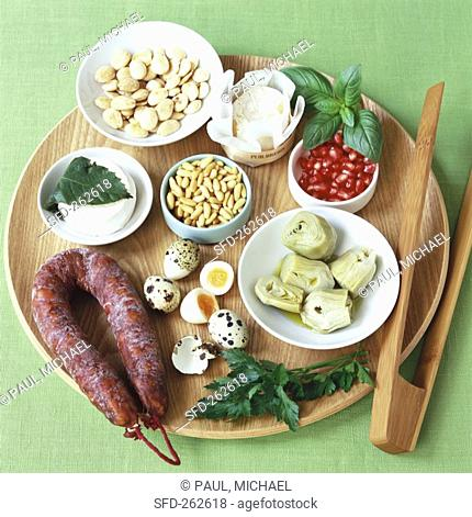 Assorted salad ingredients on wooden platter
