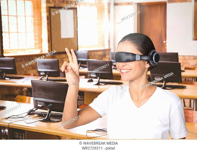 Businesswoman gesturing while using virtual reality headset in office