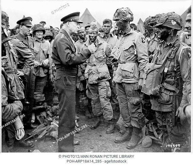 """General Dwight D. Eisenhower gives the order of the day;  """"""""Full victory--nothing else"""""""" to paratroopers somewhere in England;  just before they board their..."""