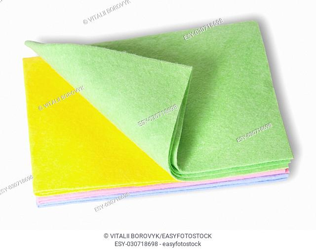 Multicolored cleaning cloths folded on top isolated on white background