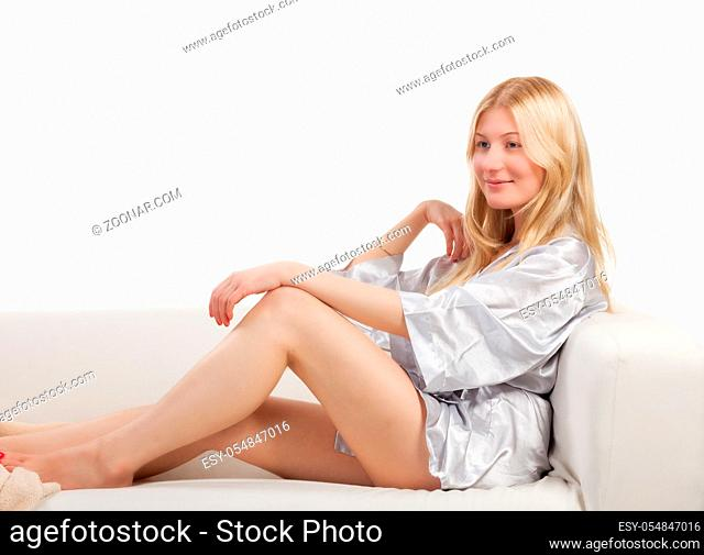 portrait of beautiful sexy blonde woman in pajamas lingerie on white background