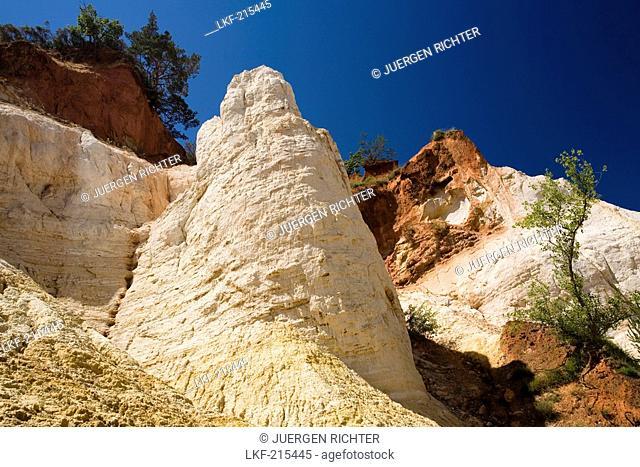 Colorado Provencal, rocks of ochre under a blue sky, Rustrel, Vaucluse, Provence, France