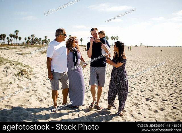 Family of Five Walking on Beach