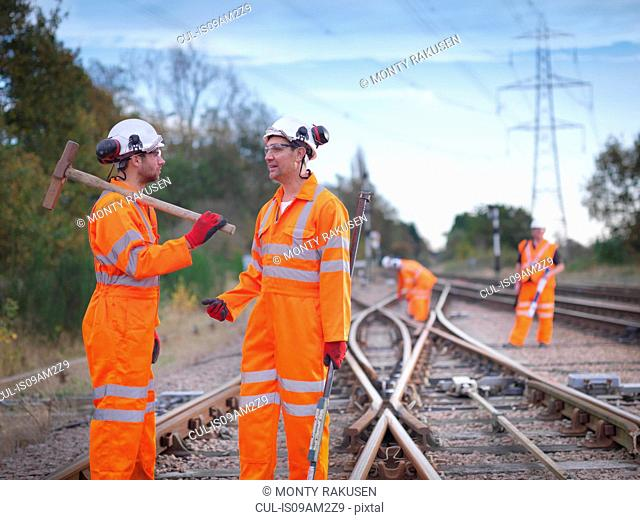 Railway maintenance workers in discussion on track