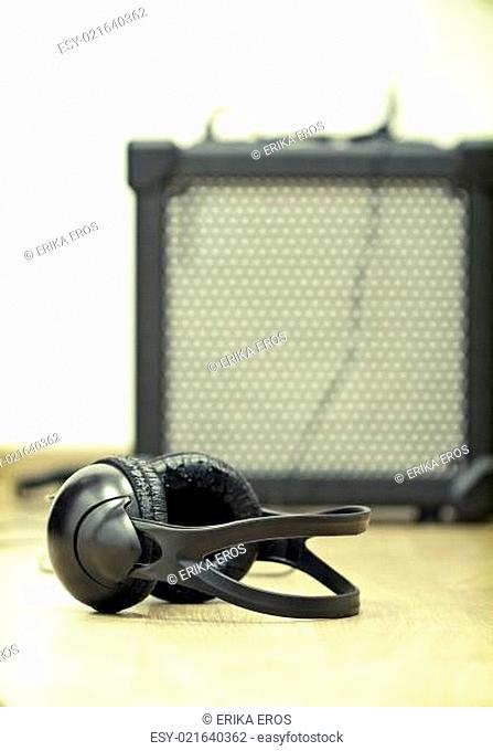Headphones and guitar amplifier