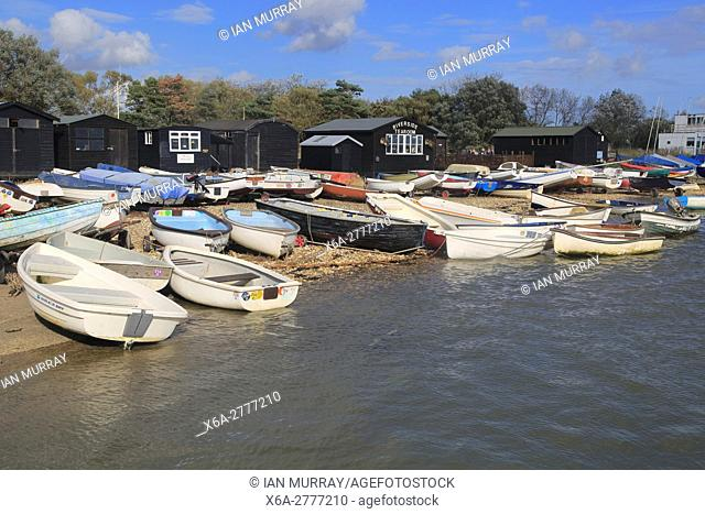 Dinghy boats and black wooden fishing sheds, River Ore, Orford, Suffolk, England, UK