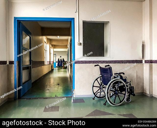 Wheelchair at empty hospital hall in montevideo city, uruguay