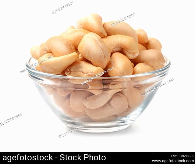 Glass bowl of cashew nuts isolated on white