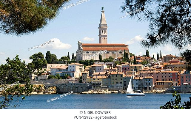 The old town of Rovinj in Croatia, dominated by the Cathedral of St Euphemia and viewed from its neighbour the Island of Sveti Katarina St Catherine's Island...