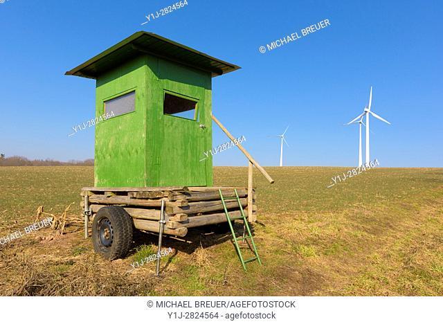 Hunting blind and wind turbines, Hesse, Germany, Europe