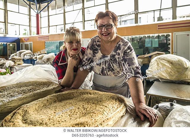 Armenia, Yerevan, G. U. M. Market, food market hall, vendor of lavash flat bread, MR